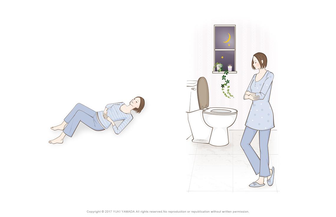 頻尿に悩む女性、お腹のマッサージをする女性
